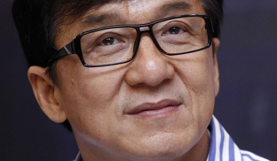 """FILE - In this Dec. 18, 2013, file photo, Hong Kong actor Jackie Chan listens to a question during a news conference to promote his new film """"Police Story 2013"""" in Kuala Lumpur, Malaysia. Chan, film editor Anne V. Coates, casting director Lynn Stalmaster and documentarian Frederick Wiseman are getting Oscars. The film academy announced Thursday, Sept. 1, 2016, that the four industry veterans will receive Oscar statuettes at the annual Governors Awards ceremony in November. (AP Photo/Lai Seng Sin, File)"""