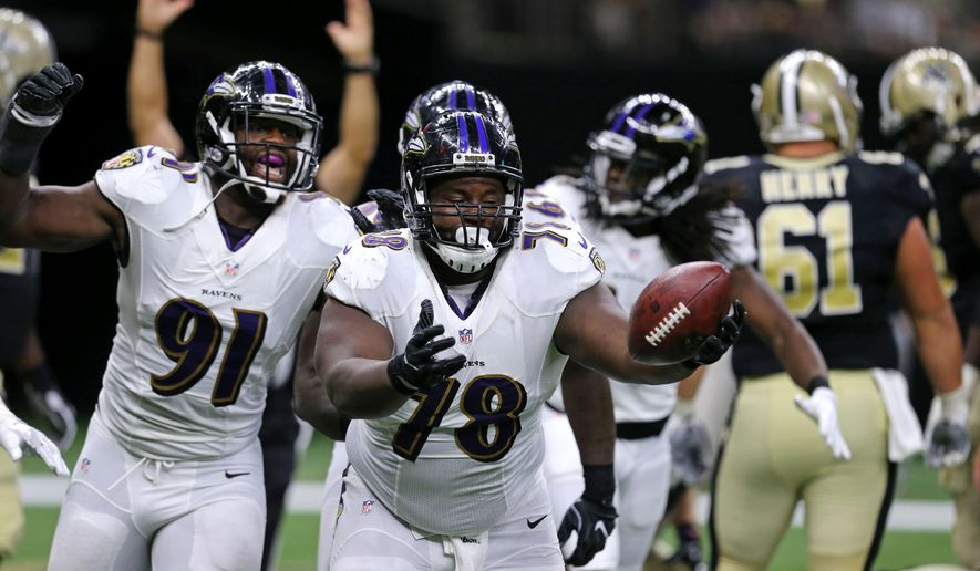 Baltimore Ravens defensive tackle Michael Pierce (78) celebrates after recovering a fumble in the end zone by New Orleans Saints quarterback Drew Brees for a touchdown in the first half of a pre-season NFL football game in New Orleans, Thursday, Sept. 1, 2016. (AP Photo/Butch Dill) ** FILE **