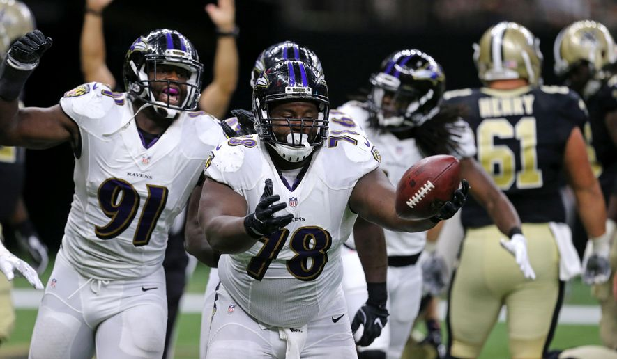 Baltimore Ravens defensive tackle Michael Pierce (78) celebrates after recovering a fumble in the end zone by New Orleans Saints quarterback Drew Brees for a touchdown in the first half of a pre-season NFL football game in New Orleans, Thursday, Sept. 1, 2016. (AP Photo/Butch Dill)