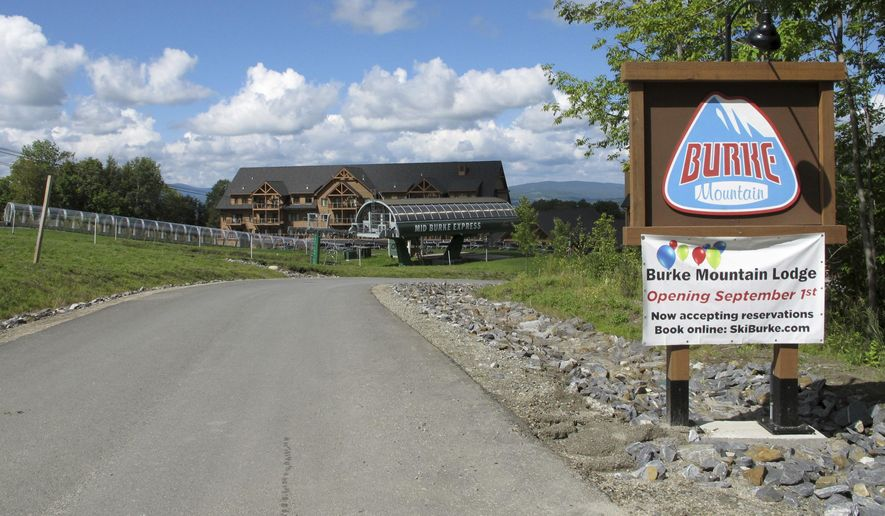 A sign invites visitors to the Lodge at Burke Mountain, Thursday, Sept. 1, 2016, the day the new hotel and conference center officially opened in East Burke, Vt. After months of delays and some doubts, the new hotel and conference center officially opened Thursday at the Vermont ski resort owned by a Miami businessman accused of defrauding foreign investors. (AP Photo/Lisa Rathke)