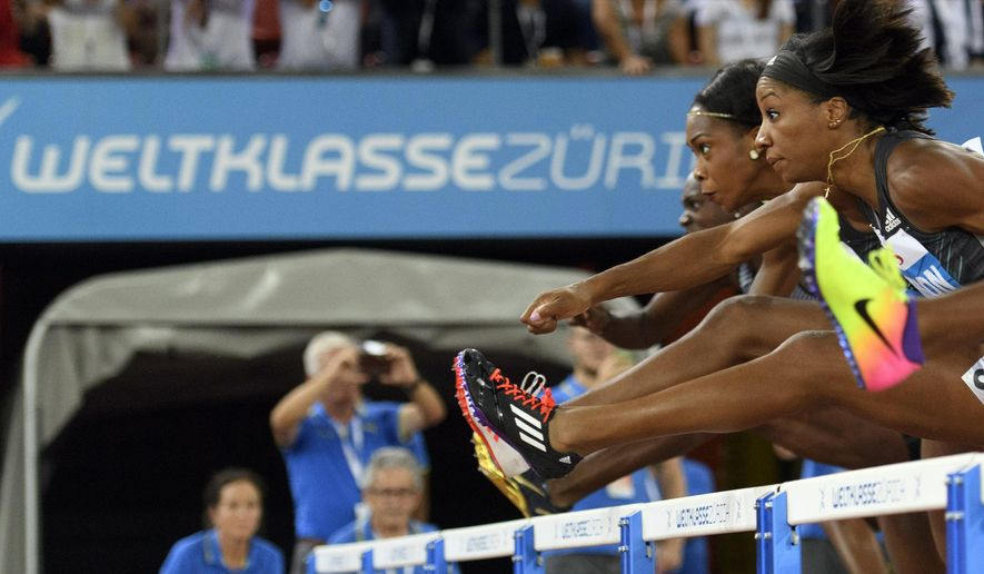Kendra Harrison from the US, right, competes in the women's 100m hurdles race, during the IAAF Diamond League international athletics meeting in the Letzigrund stadium in Zurich, Switzerland, Thursday, Sept. 1, 2016. (Ennio Leanza/Keystone via AP)