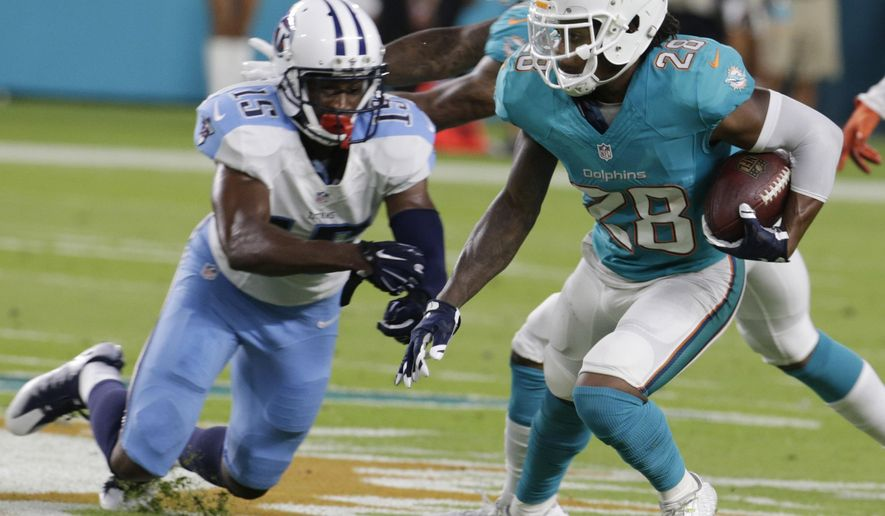 Miami Dolphins cornerback Bobby McCain (28) intercepts a pass intended for Tennessee Titans wide receiver Justin Hunter (15) during the first half of an NFL preseason football game, Thursday, Sept. 1, 2016 in Miami Gardens, Fla. (AP Photo/Lynne Sladky)