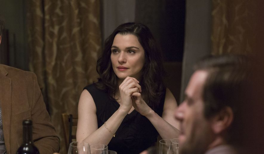 """This image released by IFC Films shows Rachel Weisz in a scene from """"Complete Unknown."""" (Jeong Park/IFC Films via AP)"""