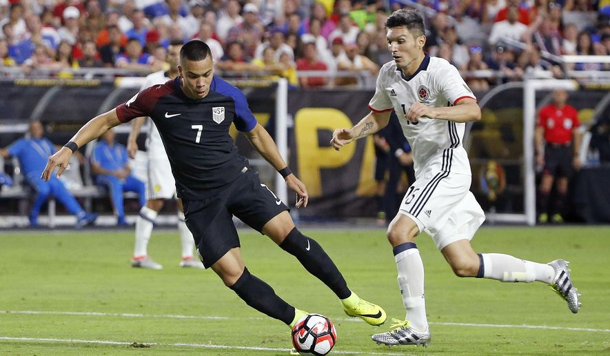 FILE - In this June 25, 2016, file photo, United States' Bobby Wood (7) tries to shoot as Colombia's Daniel Torres (16) defends during the second half of the Copa America Centenario third-place soccer match, in Glendale, Ariz. Between his surprising summer with the U.S. men's national team last year and his dazzling debut with club team Hamburg last week, it's been an impressive 14-month stretch for American forward Bobby Wood. He hopes it continues against St. Vincent and the Grenadines in a World Cup qualifier Friday. (AP Photo/Ross D. Franklin, File)
