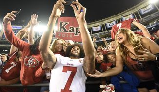 San Francisco 49ers quarterback Colin Kaepernick greets fans after their 31-21 win against the San Diego Chargers during an NFL preseason football game Thursday, Sept. 1, 2016, in San Diego.  (AP Photo/Denis Poroy)