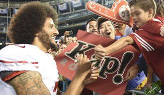 San Francisco 49ers quarterback Colin Kaepernick greets fans after their 21-31 win against the San Diego Chargers during an NFL preseason football game Thursday, Sept. 1, 2016, in San Diego.  (AP Photo/Denis Poroy)