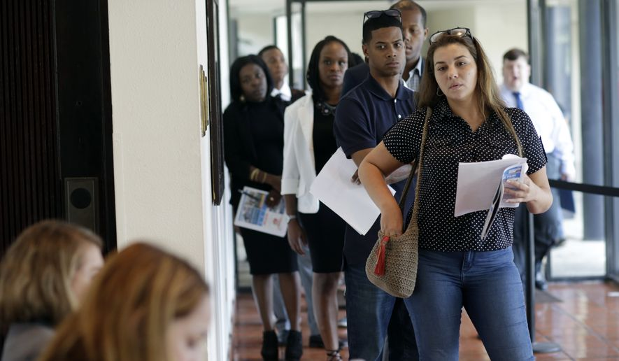 In this Tuesday, July 19, 2016, file photo, Raisa Rickie waits in line to apply for a job with Aldi at a job fair in Miami Lakes, Fla. On Friday, Sept. 2, 2016, the U.S. government issues the August jobs report. (AP Photo/Lynne Sladky) ** FILE **
