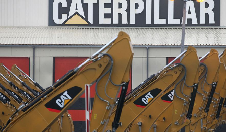 FILE - This Thursday, Feb. 28, 2013 file photo, heavy equipment is parked at the site of Caterpillar Belgium, in Gosselies, Belgium. US. Heavy equipment maker Caterpillar said Friday, Sept. 2, 2016 that it may close a Belgian manufacturing site and lay off about 2,000 employees, an announcement met by the Belgian government and company employees with dismay and alarm. (AP Photo/Yves Logghe, File)