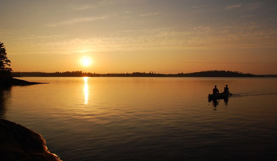 In this Aug. 12, 2011 photo, the sun sets as two paddlers make their way across Lac La Croix in the Boundary Waters Canoe Area Wilderness near Ely, Minn. New data from the U.S. Forest Service shows a recent increase in the number of people visiting the Boundary Waters Canoe Area Wilderness. But overall, visitor numbers have been on a downward trend in recent years, and the average age of those visitors has gotten much older.  (Nathaniel Minor/Minnesota Public Radio via AP)