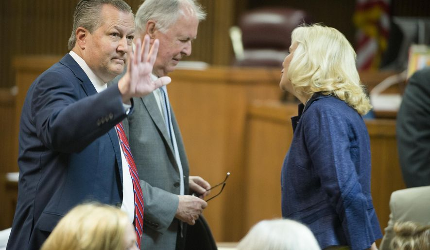 Mike Hubbard, former Alabama Speaker of the House, waives before a post trial hearing at the Lee County Justice Center in Opelika, Ala., on Friday, Sept. 2, 2016. Hubbard is seeking a new trial after being convicted on 12 felony ethics charges and removed from office. (Albert Cesare//The Montgomery Advertiser via AP, Pool)