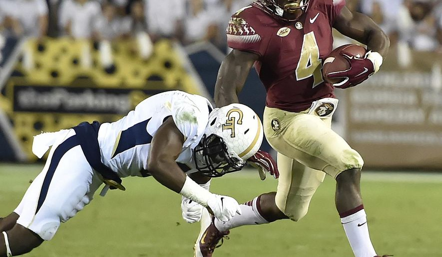 FILE - In this Oct. 24, 2015, file photo, Florida State running back Dalvin Cook (4) runs against Georgia Tech defensive back Step Durham (8) during an NCAA college football game in Atlanta. Florida State faces Mississippi on Monday night, Sept. 5. Cook is one of the best running backs in the country and safety Derwin James is a versatile playmaker on defense. (AP Photo/Jon Barash, File)
