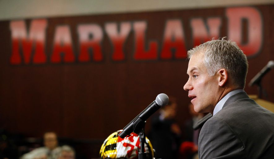 FILE - In this Dec. 3, 2015, file photo, D.J. Durkin speaks at a news conference after being introduced as the new head football coach at the University of Maryland, in College Park, Md. Durkin insists his first game as Maryland's football coach isn't about him. Truth is, that is by far the most interesting aspect of Saturday's matchup between the Terrapiins and Howard.  (AP Photo/Patrick Semansky, File)