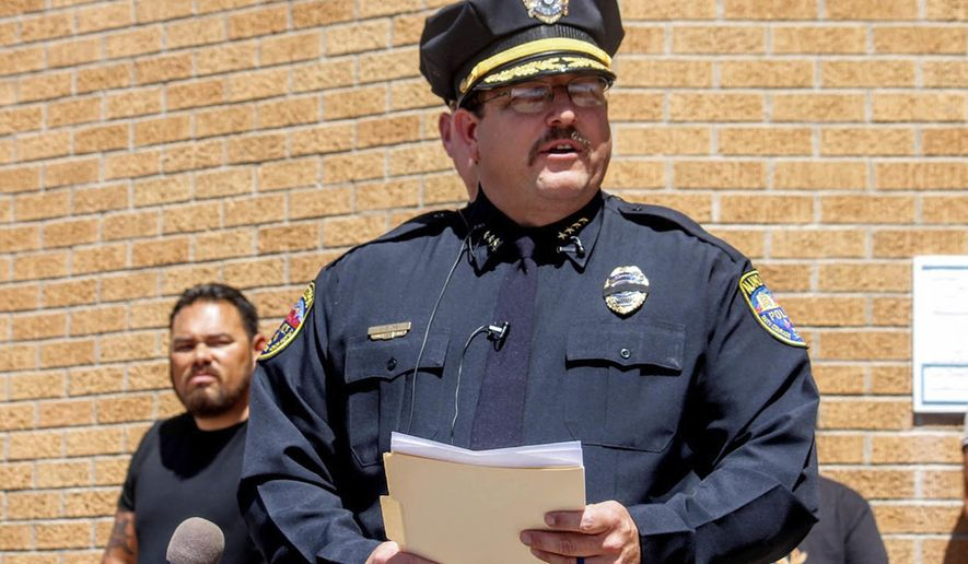 Alamogordo, N.M., Police Chief Daron Syling speaks at a press conference outside police headquarters Friday, Sept. 2, 2016. He said 33-year-old Alamogordo Police Officer Clint Corvinus died from his injuries at Gerald Champion Regional Medical Center after being struck by gunfire. Authorities say Corvinus pursued a 38-year-old man with three active arrest warrants and was fatally shot by the suspect Friday after gunfire erupted in a residential area of Alamagordo. The suspect was also killed. (Jacqueline Devine/Alamogordo Daily News via AP)