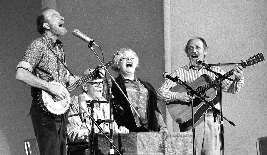 FILE - In this Nov. 28, 1980, file photo, the Weavers perform in a 25th Anniversary reunion concert at Carnegie Hall in New York. From left are: Pete Seeger, Lee Hays, Ronnie Gilbert and Fred Hellerman. Hellerman died Thursday, Sept. 1, 2016 at his home in Weston, Conn., after a lengthy illness, his son Caleb Hellerman said. He was 89. (AP Photo/Richard Drew, File)