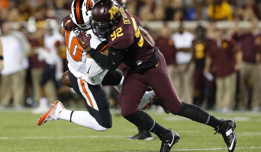 Minnesota defensive lineman Tai'yon Devers (92) sacks Oregon State quarterback Darell Garretson during the the first half of an NCAA college football game, Thursday, Sept. 1, 2016, in Minneapolis. (AP Photo/Stacy Bengs)