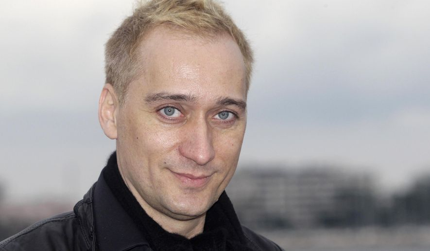 FILE - In this Jan. 30, 2012 file photo, German Electronic Dance Music DJ and record producer Paul Van Dyk poses at the 46th MIDEM (International record music publishing and video music market) in Cannes, southern France. Van Dyk's website and Twitter accounted were hacked and racist messages were posted. A spokesman for the DJ says he did not post any racist messages Thursday, Sept. 1, 2016, on Twitter. (AP Photo/Lionel Cironneau, File)