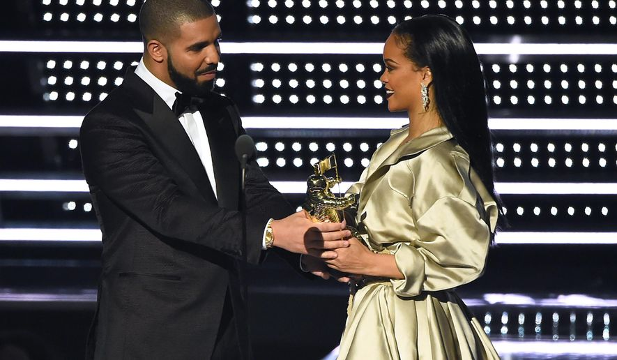 """FILE - In this Aug. 28, 2016, file photo, Drake, left, presents the Michael Jackson Video Vanguard Award to Rihanna at the MTV Video Music Awards at Madison Square Garden in New York. Rihanna thanked Drake on Instagram Friday, Sept. 2, 2016, for his presentation, calling the rapper's speech """"touching."""" (Photo by Charles Sykes/Invision/AP, File)"""