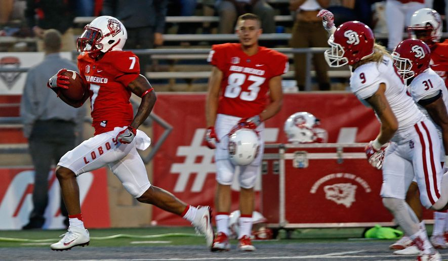 New Mexico running back Teriyon Gipson (7) sprints to the end zone for a touchdown ahead of South Dakota defensive backs Andrew Gray (9) and Doug Lewis (31) during the first half of an NCAA college football game in Albuquerque, N.M., Thursday, Sept. 1, 2016. (AP Photo/Andres Leighton)