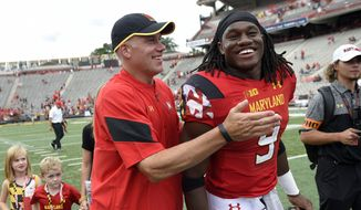 Maryland head coach DJ Durkin, left, reacts with running back Trey Edmunds (9) as the walk off after an NCAA football game against Howard, Saturday, Sept. 3, 2016, in College Park, Md. Maryland won 52-13. (AP Photo/Nick Wass)