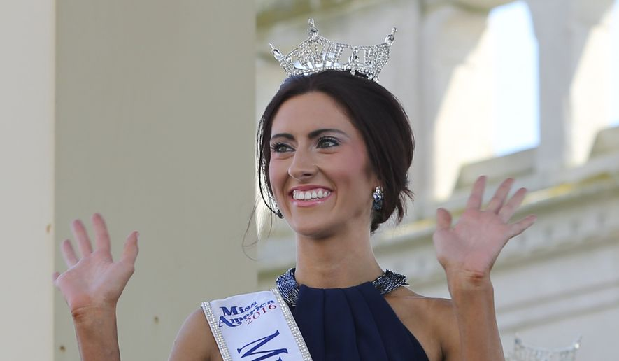 In this Tuesday, Aug. 30, 2016, photograph, Miss Missouri, Erin O'Flaherty waves as she is introduced during Miss America Pageant arrival ceremonies in Atlantic City. O'Flaherty, is the first openly lesbian contestant to win a state title in the Miss America pageant. Her platform is suicide prevention, an issue she says is particularly important with young gay people. (AP Photo/Mel Evans)