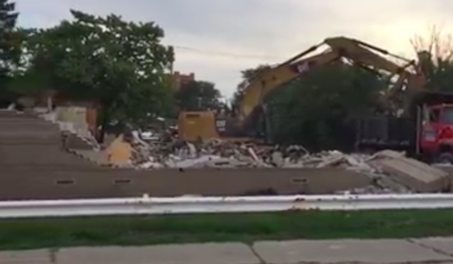 Screen capture from a Facebook video of demolition of a Toledo Planned Parenthood abortion clinic. A pro-life monument is being erected on the site. [https://www.facebook.com/lynn.mills.399/videos/vb.697867478/10154137687162479/?type=2&theater]