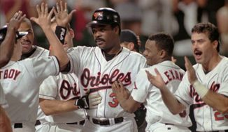 Baltimore Orioles Eddie Murray, center, is mobbed by teammates as he returns to home plate after hitting his 500th career home run against the Detroit Tigers Friday, Sept. 6, 1996 at Camden Yards.  At far right is Orioles Rafael Palmeiro and beside him is Manny Alexander.(AP Photo/Roberto Borea)