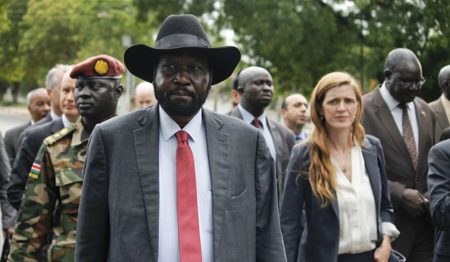 South Sudan's President Salva Kiir, left, takes members of the U.N. Security Council, including U.S. Ambassador to the United Nations Samantha Power, right, on a tour outside the presidential compound in the capital Juba, South Sudan, Sunday, Sept. 4, 2016. South Sudan has agreed to the deployment of a 4,000-strong regional protection force approved by the U.N. Security Council after first rejecting the peacekeepers as a violation of its sovereignty. (AP Photo/Justin Lynch) **FILE**