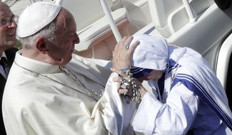 Pope Francis blesses a nun of the Sisters of the Missionaries of Charity as he leaves at the end of the Canonization Mass of Mother Teresa in St. Peter's Square, at the Vatican on Sunday. (Associated Press)