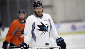 FILE - In this May 27, 2016 file photo, San Jose Sharks' Joe Pavelski skates during an NHL hockey practice in San Jose, Calif.   The San Jose Sharks center, coming off a trip to the Stanley Cup finals, has had the shortest of summers. Pavelski along with the best hockey players in the world will be reporting to World Cup camps on Monday, Sept. 5,. (AP Photo/Marcio Jose Sanchez)