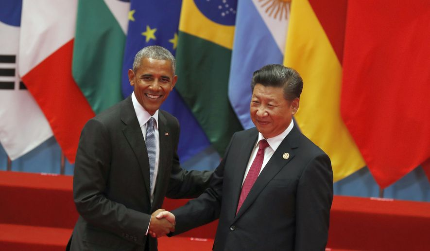 U.S. President Barack Obama, left, shakes hands with China's President Xi Jinping before a group photo session for the G20 Summit in Hangzhou in eastern China's Zhejiang province, Sunday, Sept. 4, 2016. (AP Photo/Ng Han Guan)