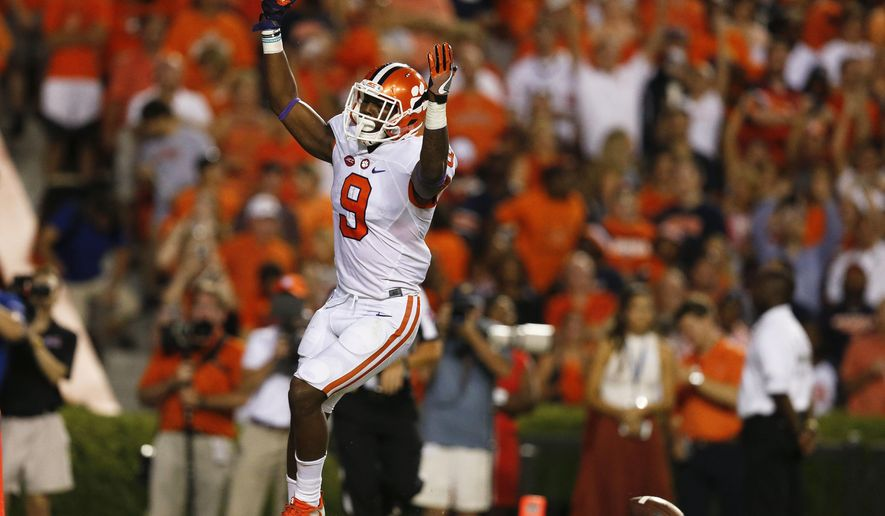 Clemson running back Wayne Gallman celebrates after scoring a touchdown during the first half of an NCAA college football game against Auburn, Saturday, Sept. 3, 2016, in Auburn, Ala. (AP Photo/Brynn Anderson)