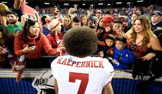 San Francisco 49ers quarterback Colin Kaepernick has been getting support in his protest from fans, other athletes and even President Obama. (Associated Press)