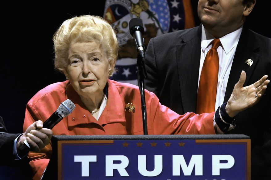 In this March 11, 2016 photo, longtime conservative activist Phyllis Schlafly, 91, endorses Republican presidential candidate Donald Trump before Trump begins speaking at a campaign rally in St. Louis. Her support for Trump has led to internal strife _ and what she claims was an attempt to oust her _ at the organization she formed nearly a half-century ago to fight the Equal Rights Amendment.   (AP Photo/Seth Perlman)