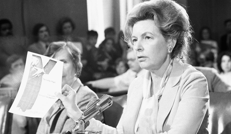Phyllis Schlafly holds up a book she describes as sexual harassment during a Senate Labor and Human Resources Committee Hearing on Tuesday, April 22, 1981 in Washington. (AP Photo/Harrity)