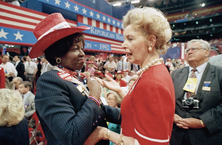 Anti-abortion leader Phyllis Schlafly, a delegate from Alton, Ill., right, talks with Juanita Crosby, a Missouri delegate from Kansas City, on the floor of the Astrodome during the opening session of the Republican National Convention in Houston, Aug. 17, 1992. Abortion rights proponents gave up their fight to force a floor debate on softening the anti-abortion plank of the party. (AP Photo/Barry Thumma)