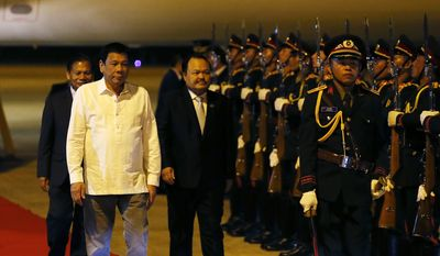 Philippine President Rodrigo Duterte reviews the troops upon arrival in Vientiane, Laos to attend the 28th and 29th ASEAN Summits and other related summits Monday, Sept. 5, 2016, in Vientiane, Laos. Laos is this year's host of the annual regional meeting and its dialogue partners that includes the United States, Canada, Russia, Japan, China, South Korea, Australia, New Zealand and India.(AP Photo/Bullit Marquez)