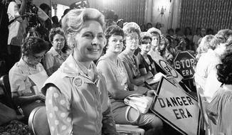 In this Aug. 10, 1976, file photo, women opposed to the Equal Rights Amendment sit with Phyllis Schlafly, left, national chairman of Stop ERA. **File (AP Photo)