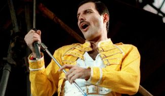 In this July 20, 1986, file photo, Queen lead singer Freddie Mercury performs, in Germany. Queen guitarist Brian May says an asteroid in Jupiter's orbit has been named after the band's late frontman Freddie Mercury on what would have been his 70th birthday, it was reported on Monday, Sept. 5, 2016. (AP Photo/Marco Arndt, File)