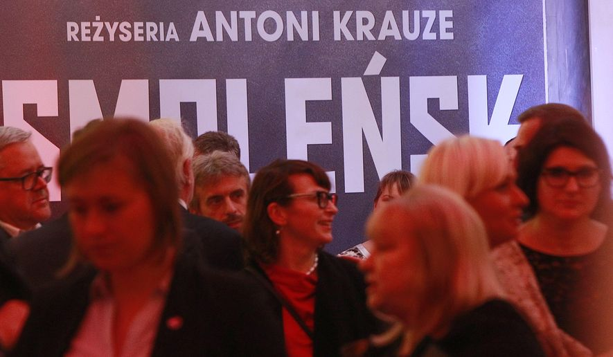 Invited guests gather for the premiere of a divisive movie 'Smolensk' at the Opera House in Warsaw, Poland, Monday, Sept. 5, 2016. The movie supports a theory that the 2010 plane crash in Russia that killed Poland's President Lech Kaczynski and 95 others was an assassination orchestrated by Russia. President Andrzej Duda attended the screening of the movie, along with the twin brother of the killed president, Jaroslaw Kaczynski, who is the ruling conservative party's leader and Poland's most powerful politician and supports the assassination theory. (AP Photo/Czarek Sokolowski)
