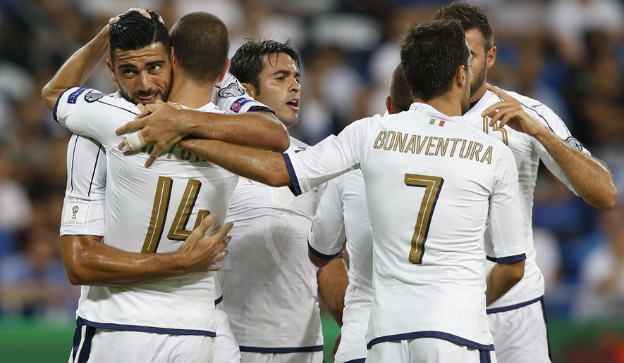 Italy's players celebrate their opening goal against Israel during the World Cup Group G qualifying soccer match in Haifa, Israel, Monday, Sept. 5, 2016. (AP Photo/Ariel Schalit)