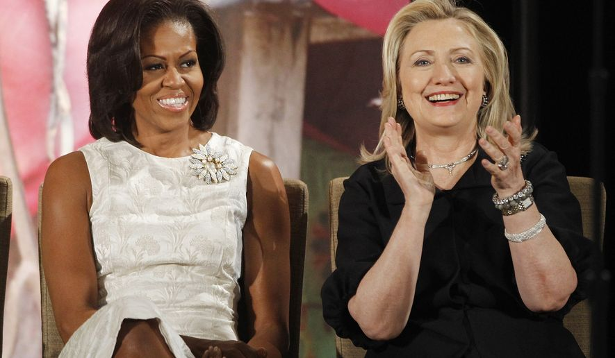Secretary of State Hillary Rodham Clinton and first lady Michelle Obama attend the 2012 International Women of Courage Awards, on the 101st Anniversary of International Women's Day,  Thursday, March 8, 2012, at the State Department in Washington. (AP Photo/Charles Dharapak)