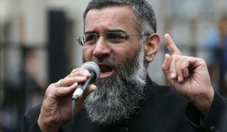 Anjem Choudary, a British Muslim social and political activist and spokesman for Islamist group, Islam4UK, speaks following prayers at the Central London Mosque in Regent's Park, London in this April 3, 2015, file photo. One of Britain's best-known radical preachers, Mr. Choudary on Tuesday Sept. 6, 2016 was sentenced to five and a half year in prison for encouraging support for the Islamic State group. (AP Photo/Tim Ireland, File) **FILE**