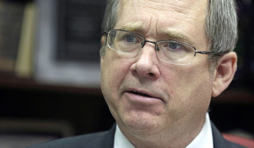Republican Sen. Mark Kirk of Illinois, who had at one point embraced Donald Trump, rescinded his support and now says he plans to write in Colin Powell, former secretary of state from the George W. Bush years. (Associated Press)