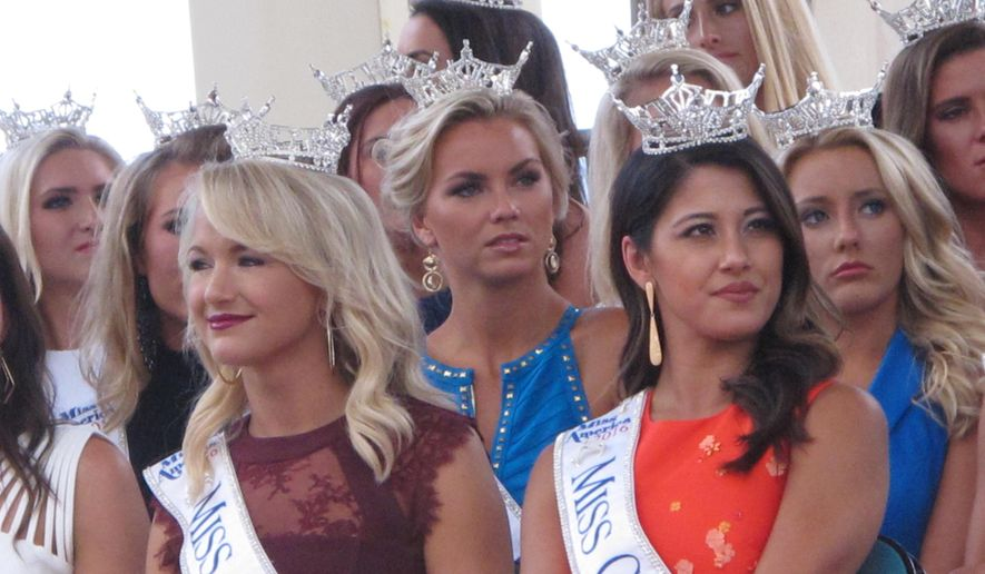 This Tuesday, Aug. 30, 2016 photo shows Miss America contestants at a welcoming ceremony in Atlantic City. The first night of preliminary competition in this year's pageant begins Tuesday night, Sept. 6, 2016, with the new Miss America being crowned on Sunday night. (AP Photo/Wayne Parry)