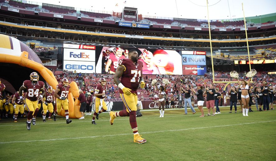 658425fbc55 The Washington Redskins led by tackle Trent Williams (71) take the field  before an