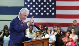 Former U.S. President Bill Clinton campaigns for his wife, Democratic presidential candidate Hillary Clinton, Wednesday, Sept. 7, 2016, at Dr. James R. Smith Neighborhood Center in Orlando, Fla.  (Red Huber/Orlando Sentinel via AP)