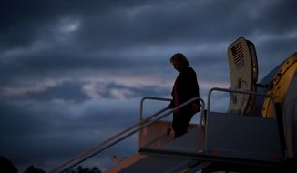 Democratic presidential candidate Hillary Clinton arrives at at Westchester County Airport in Westchester, N.Y., Tuesday, Sept. 6, 2016, from Tampa after speaking at a rally at Southern Florida University. (AP Photo/Andrew Harnik)