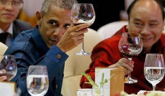 US President Barack Obama, left, makes a toast during the gala dinner of ASEAN leaders and its Dialogue Partners in the ongoing 28th and 29th ASEAN Summits and other related summits at the National Convention Center Wednesday, Sept. 7, 2016 in Vientiane, Laos. At right is Vietnamese Prime Minister Nguyen Xuan Phuc.(AP Photo/Bullit Marquez)