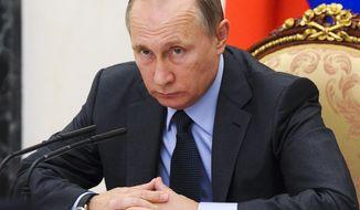 Russian President Vladimir Putin holds the Cabinet meeting in Moscow's Kremlin, Russia on Wednesday, Sept. 7, 2016. (Mikhail Klimentyev/Sputnik, Kremlin Pool Photo via AP)