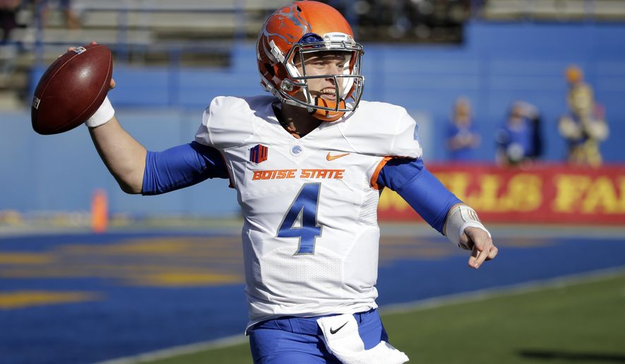 FILE -- In this Nov. 27, 2015, file photo, Boise State quarterback Brett Rypien throws against San Jose State during an NCAA college football game in San Jose, Calif. Brett Rypien opted not to follow the path of his Super Bowl MVP uncle Mark when it came time to choose a college, picking Boise State instead of Washington State. The history of the Rypien family collides this weekend when the Broncos face the Cougars. (AP Photo/Marcio Jose Sanchez, File)